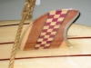 Purple heart, maple, mahogany and ebony surfboard fin by Terry Turney