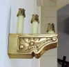 gilded corbel serves as a wall sconce