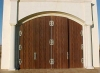 Redwood river of life pattern chapel doors can be opened to outdoor crowds